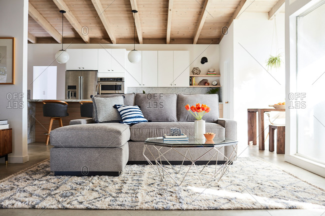 June 1, 2020: Gray sofa with chase in a modern home