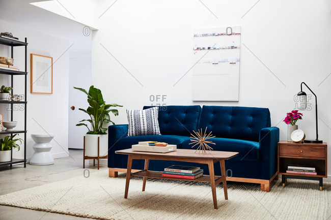 June 1, 2020: Blue velvet sofa in an airy living room