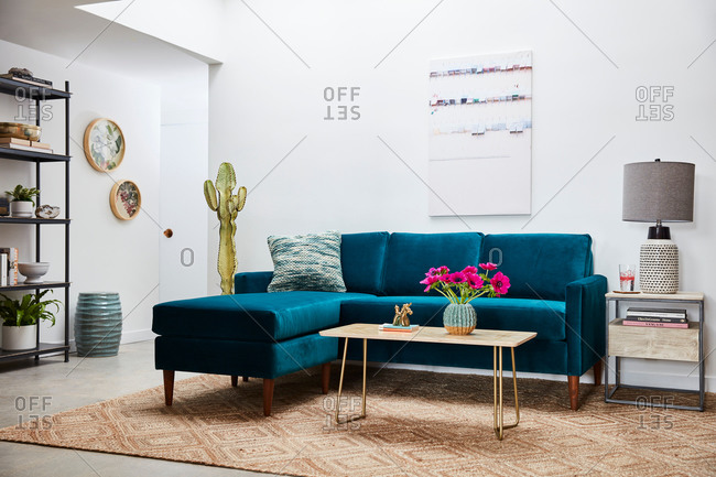 June 1, 2020: Blue velvet sectional sofa in modern airy living room