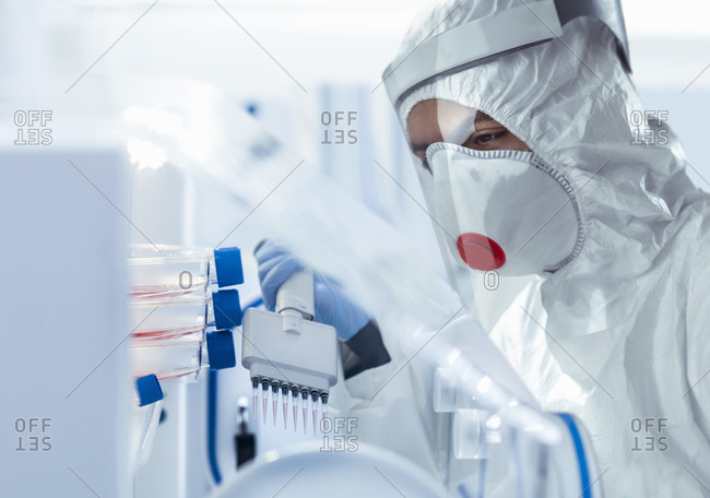 Scientist in medical research facility researching for Covid-19 vaccine.