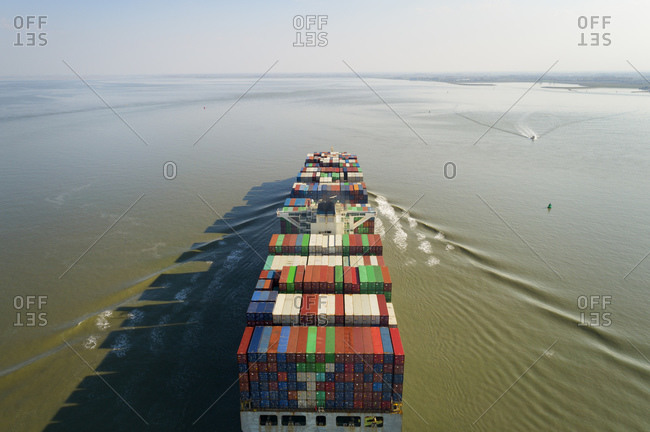 High angle view of large container ship heading towards the port of Antwerp, Belgium.