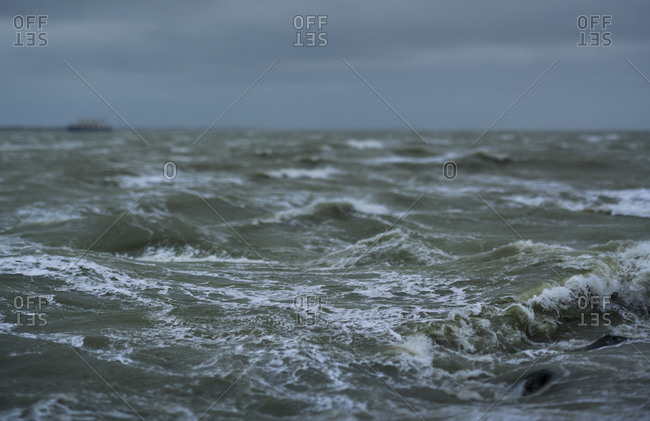 Storm battering the coast of the Wadden Sea nature reserve in Friesland, The Netherlands.
