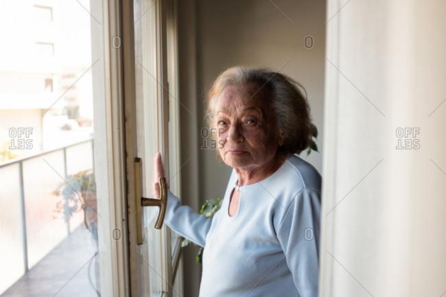 Senior woman self isolating in her home during Corona virus crisis.