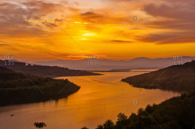 Sunset over Lake Omodeo, an artificial lake in central west Sardinia, Italy.