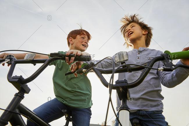 Two boys riding their BMX bikes.