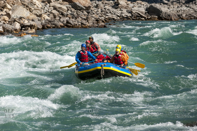 Rafting through white water rapids on the Karnali river in west Nepal
