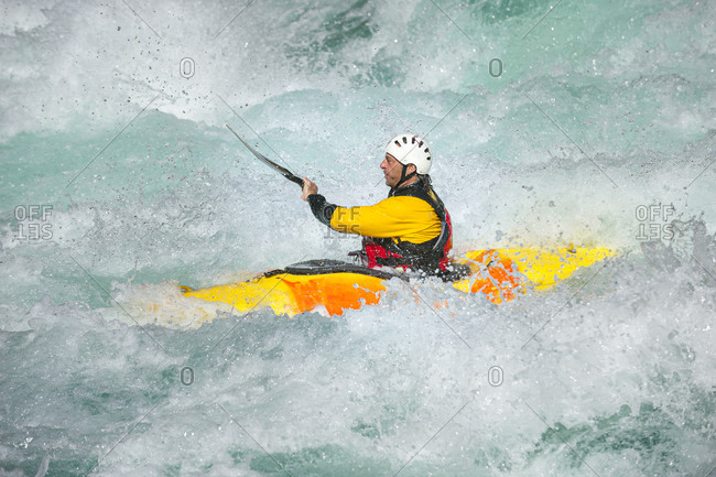A kayaker negotiates his way through whitewater rapids on the Karnali River in west Nepal