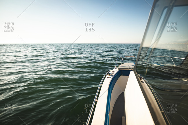 Magnificent view of waves and sunlight reflecting on the waves of the sea, a window of the boat seen in the foreground
