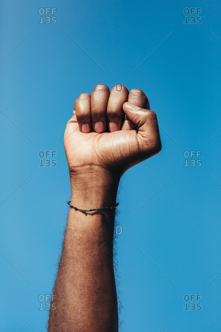 Fist of anonymous person as a gesture against racism.