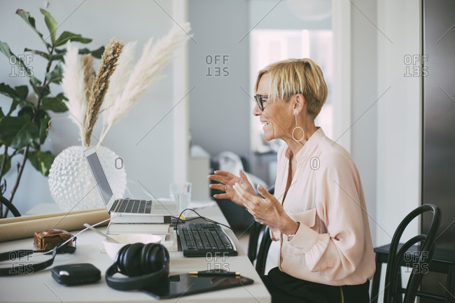Profile of woman attending video conference at home