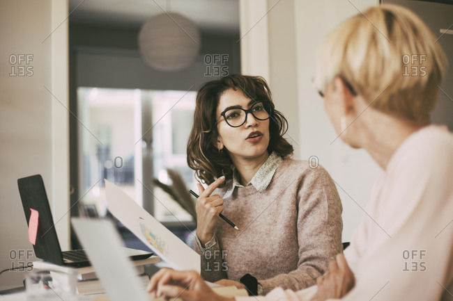 Women having a conversation in office at home