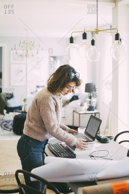 Woman setting up workplace at home
