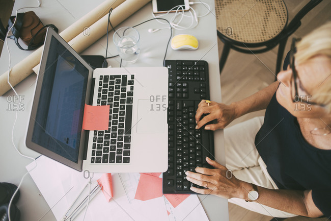 Aerial view of woman working in office at home