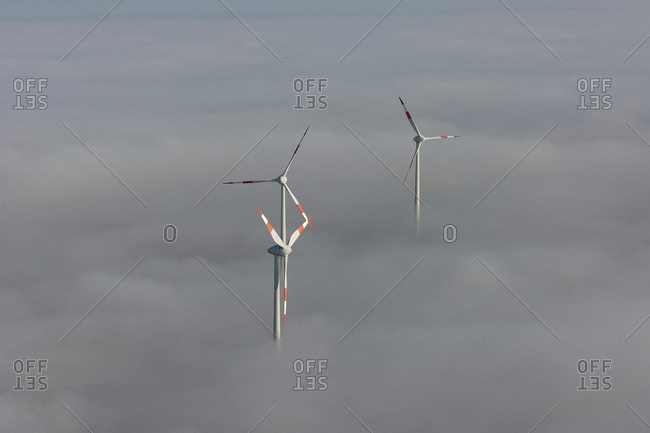 Aerial view, wind turbines sticking out from cloud cover, Heldrungen, Thuringia, Germany, Europe