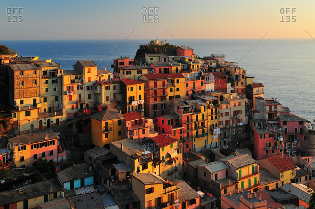 The village of Manarola and the sea in the evening light, Manarola, Cinque Terre, Liguria, Italy, Europe