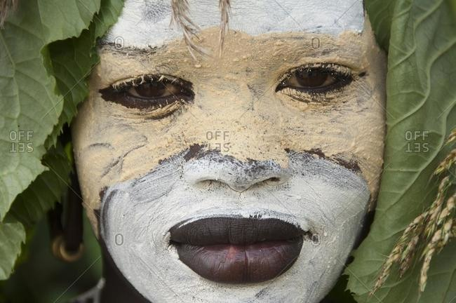 May 21, 2020: Surma woman portrait with face painting, Kibish, Omo valley Valley, Ethiopia, Africa