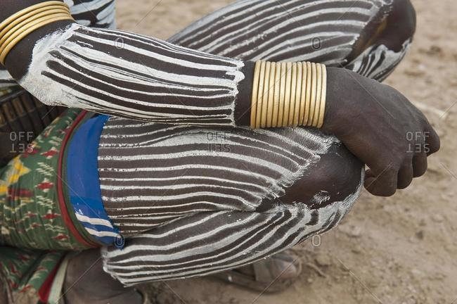 Karo man with painted legs, Omo river valley, Southern Ethiopia, Africa