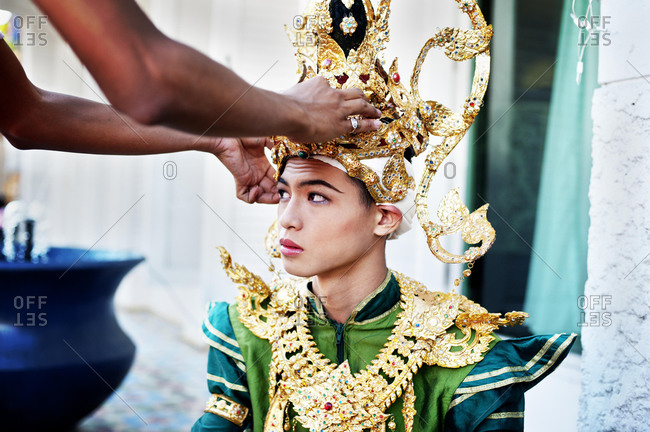 May 21, 2020: Young man putting on traditional Thai ceremonial costume, Chiang Mai, Thailand, Asia