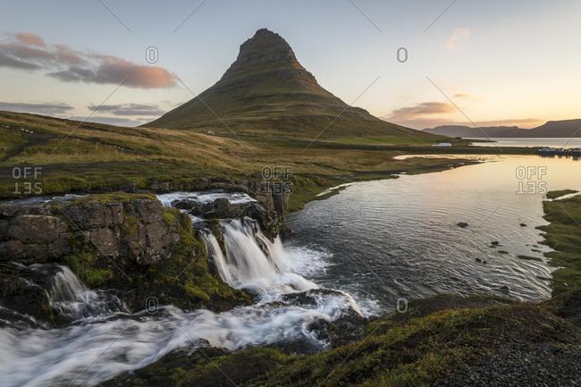 Sunrise on Kirkjufell mountain with waterfall Kirkjufellfoss, Grundafjoerdur, West Iceland, Iceland, Europe