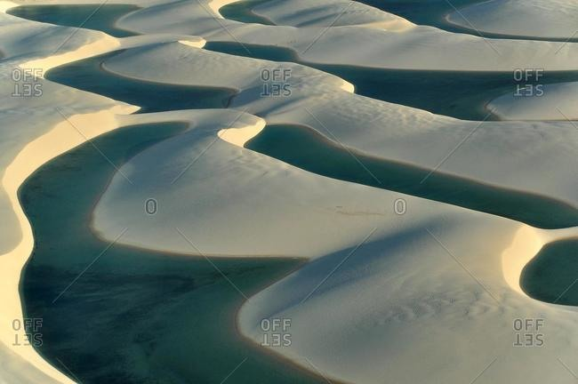 Crystal-clear lagoon in the desert of Lencois Maranhenses, Maranhao, Brazil, South America