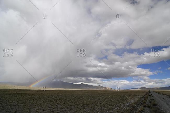 Rainbow over the Changtang high plateau, Lungkar mountains, Western Tibet, Ngari Province, Tibet, China, Asia
