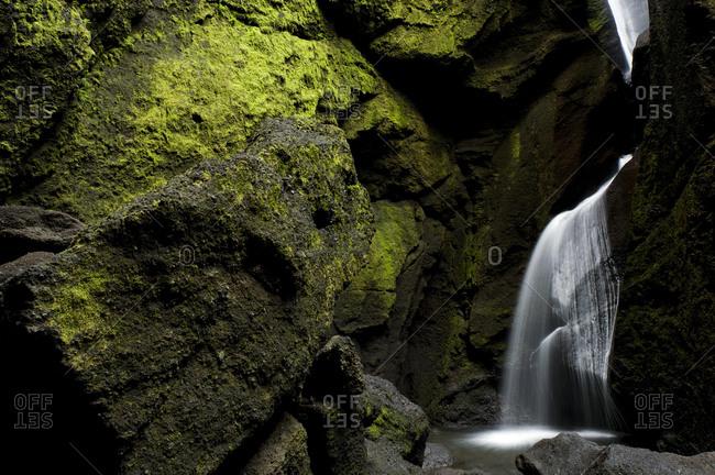Cave waterfall in the Stakkholtsgja gorge, Porsmoerk or Thorsmoerk mountain ridge, Icelandic highlands, Southern Iceland, Iceland, Europe