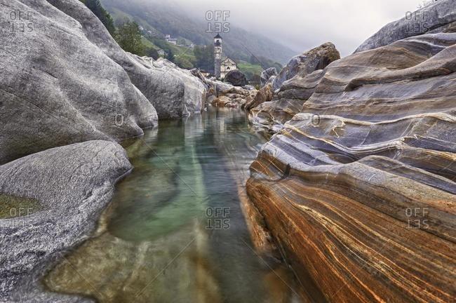 Abraded stones with river water, Lavertezzo, Valle Verzasca, Verzasca Valley, Ticino, Switzerland, Europe