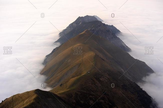 Mountain valley under fog with mountain peaks in the evening light, Allgaeu Alps, Kleinwalsertal valley, Vorarlberg, Austria, Europe