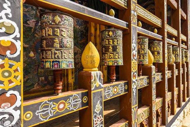 May 21, 2020: Prayer mills and mural painting in the monastery fortress, Trongsa Dzong, Trongsa, Himalayan region, Bhutan, Asia