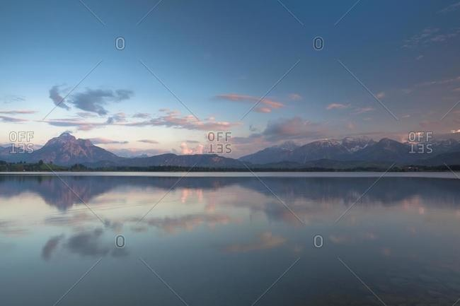 Evening mood at Hopfensee Lake with a view towards the Alps, Hopfensee in Allgaeu near Fuessen, Bavaria, Germany, Europe