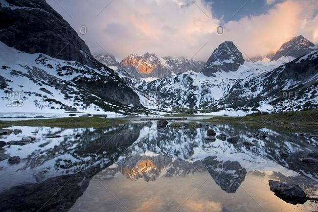 Lake Seebensee near Zugspitze Mountain with reflections in the evening light, Ehrwald, Austria, Europe