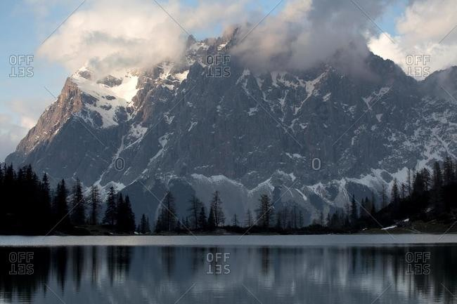 Lake Seebensee near Zugspitze Mountain in the evening light with reflections, Ehrwald, Austria, Europe