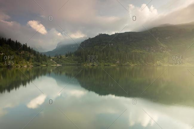 Atmospheric fog on Garichti Reservoir, Canton of Glarus, Switzerland, Europe