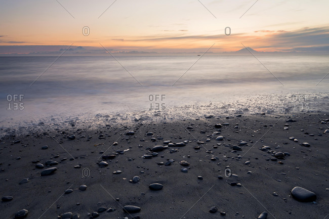 View towards volcanic mountains from the beach at Whiskey Gulch, left, Mount Iliamna, and right, Mount Redoubt, Cook Inlet, Aleutian Range, Alaska, USA, North America