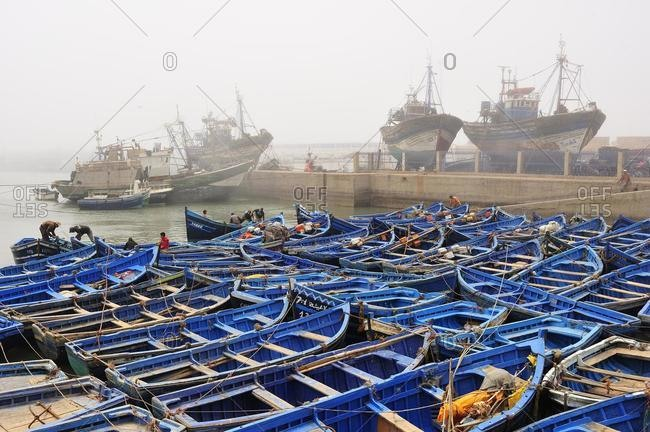 May 21, 2020: Small blue fishing boats and trawlers in the fishing port of Essaouira, Atlantic coast, Morocco, Africa