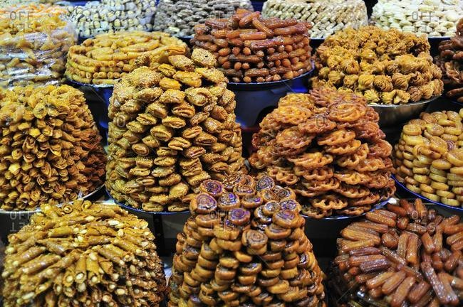 Sweets baked in oil being sold in the souk, bazaar, for Ramadan, Meknes, Morocco, Africa