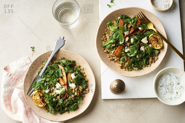 Vegetarian lunch, lentil salad with honey-roasted carrots, kale and goat cheese