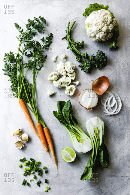 Selection of fresh vegetables on a marble background.