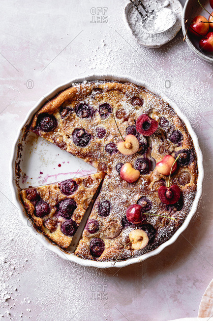Cherry clafoutis dusted with icing sugar.