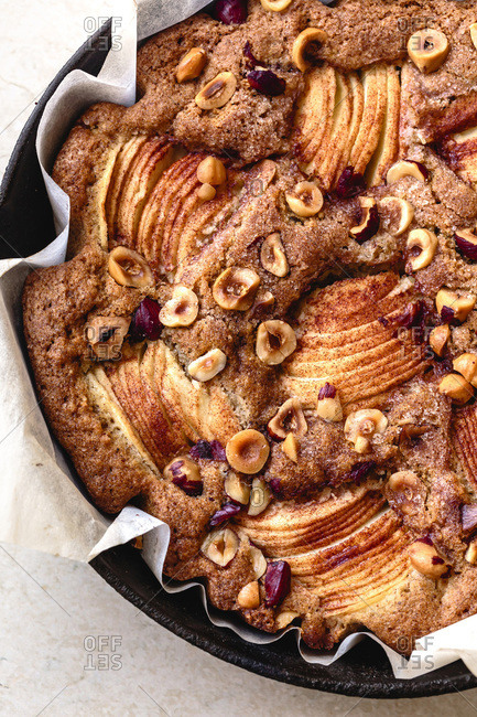 Closeup view of an apple hazelnut skillet cake
