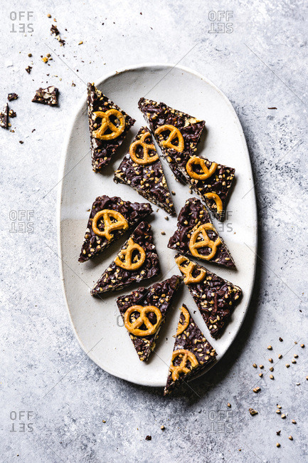 Pieces of chocolate pretzel bark on a plate.