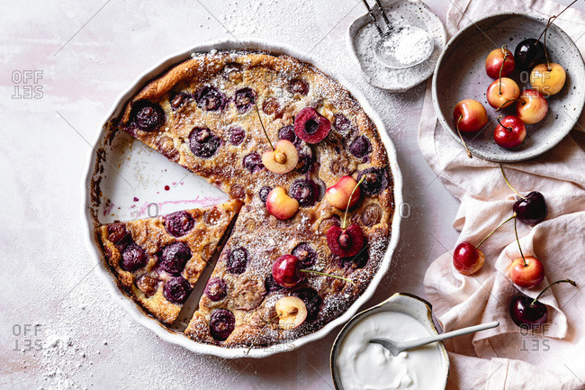 Gluten free cherry clafoutis with creme fraiche and powdered sugar.