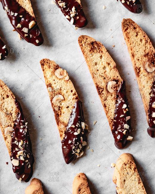 Closeup view of chocolate dipped hazelnut biscotti.