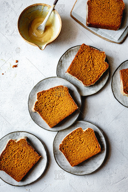 Gluten free pumpkin bread on serving plates.
