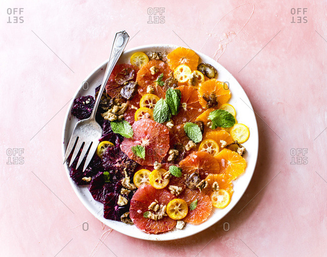 Citrus salad on a plate with a fork.