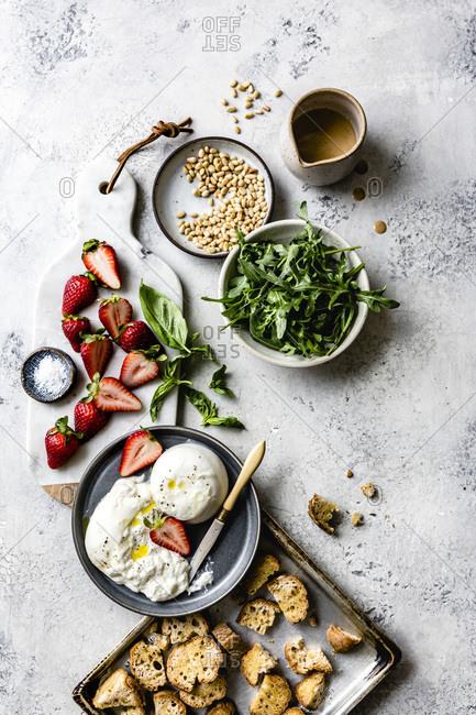 Ingredients for strawberry burrata Panzanella salad.