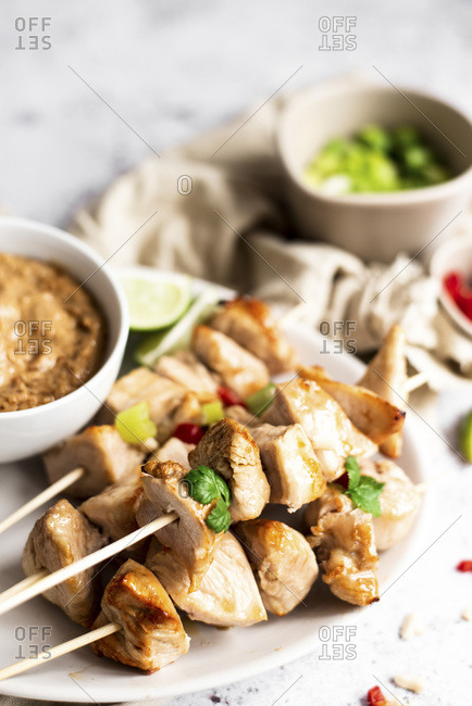 Chicken Skewers With Satay Sauce And Spring Onion And Chili Pepper Sides