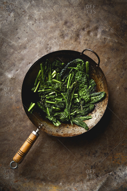 Cooked Kale in Wok with fresh ingredients