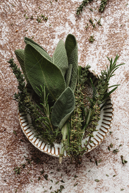 Rosemary, thyme and sage into a mini bowl
