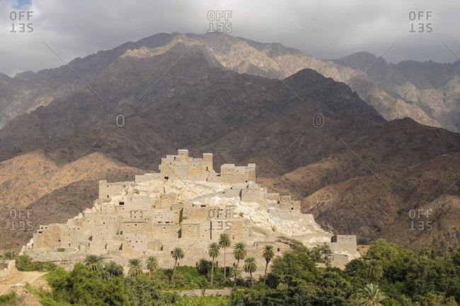 Amazing landscape of remote ancient Marble Village in Al Bahah locating against cloudy sky in summer cloudy day in Saudi Arabia